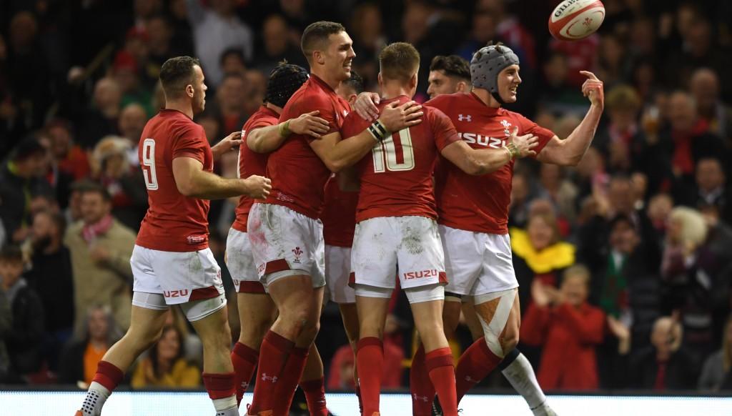 Wales celebrate Jonathan Davies' (r) try.