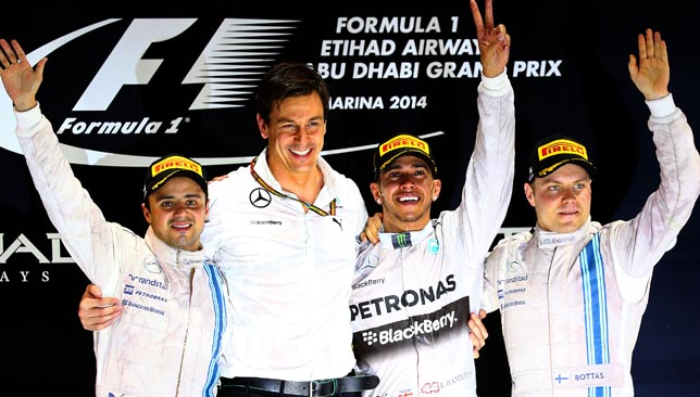 Lewis Hamilton, with Toto Wolff, Felipe Massa (l) and Valtteri Bottas (r).