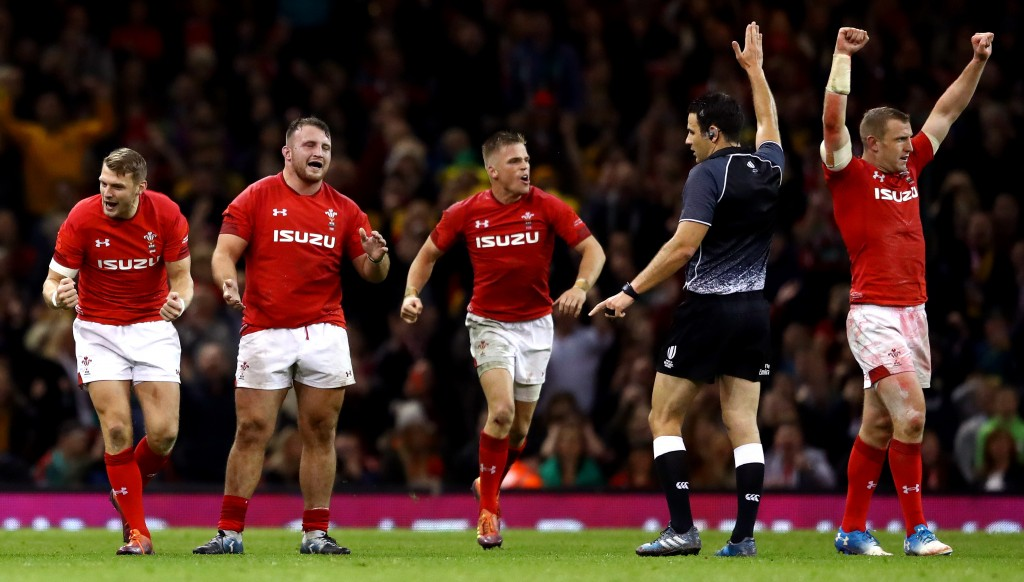 Wales player celebrate their historic victory.