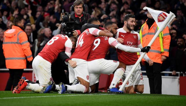 Arsenal moved above their rivals following a thrilling 4-2 win.