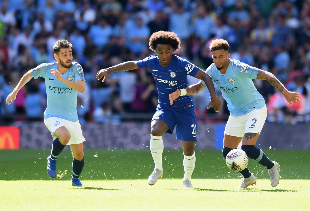 Willian of Chelsea holds off Kyle Walker of Manchester City
