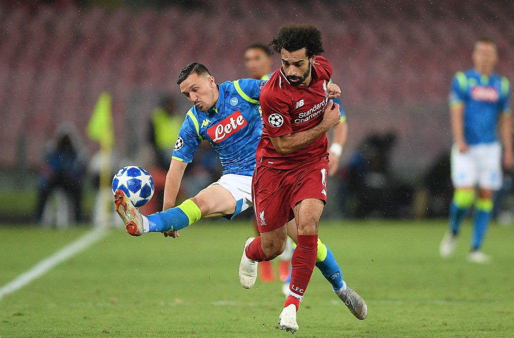Mario Rui of SSC Napoli vies Mohamed Salah of Liverpool during the Group C match of the UEFA Champions League between SSC Napoli and Liverpool