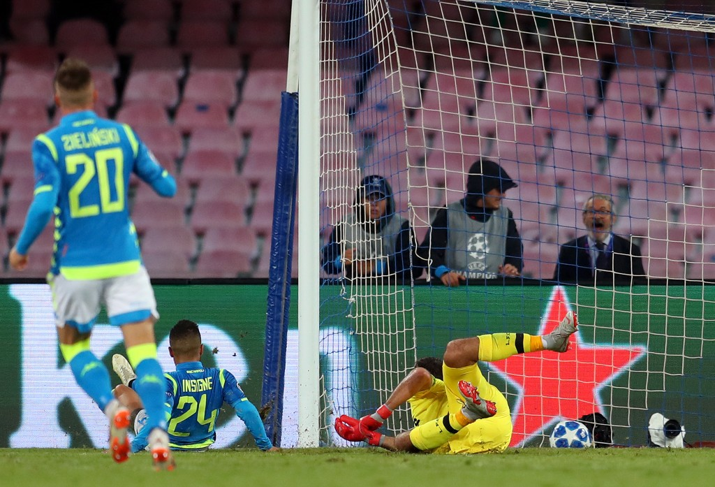 Lorenzo Insigne of Napoli (24) scores his team's first goal past Alisson of Liverpool during the Group C match of the UEFA Champions League between SSC Napoli and Liverpool