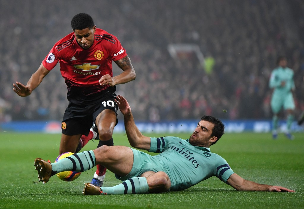 Sokratis Papastathopoulos of Arsenal tackles Marcus Rashford of Manchester United during the Premier League match between Manchester United and Arsenal FC