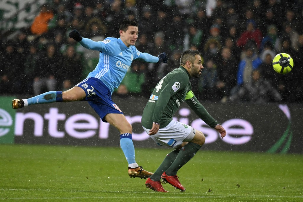 Marseille's French midfielder Florian Thauvin (L) kicks the ball to score a goal during the French L1 football match between AS Saint-Etienne and Olympique de Marseille