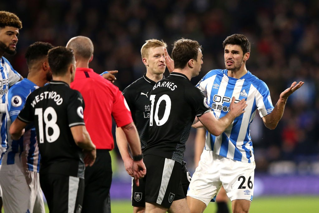 HUDDERSFIELD, ENGLAND - JANUARY 02: Christopher Schindler of Huddersfield Town argues with the referee after being shown a red card during the Premier League match between Huddersfield Town and Burnley FC at John Smith's Stadium on January 2, 2019 in Huddersfield, United Kingdom. (Photo by Alex Livesey/Getty Images)