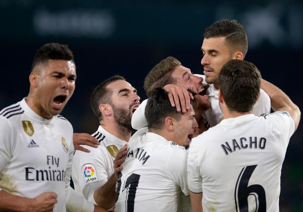 Dani Ceballos celebrates with his Real Madrid team-mates