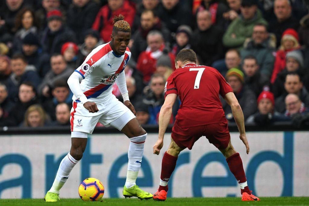 Crystal Palace's Wilfried Zaha takes on James Milner
