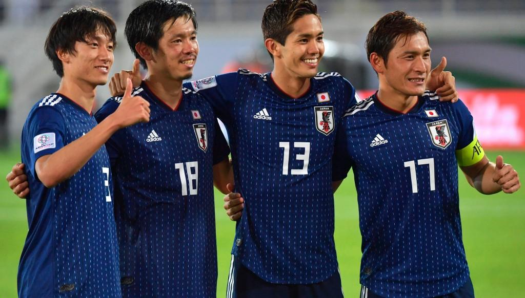 Yoshinori Muto (2nd r) and Tsukasa Shiotani (2nd l) celebrate after their win.
