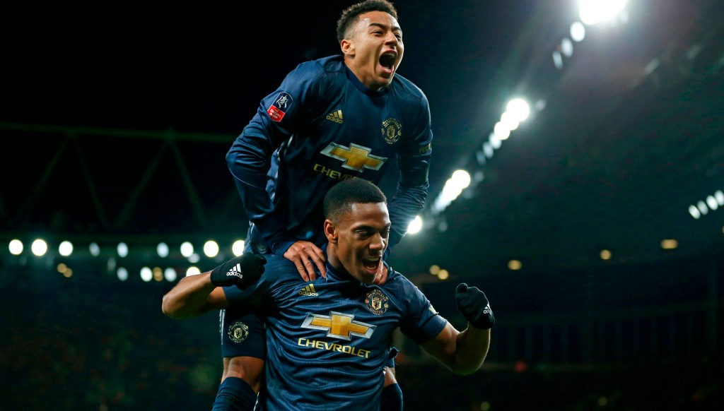 Jesse Lingard and Anthony martial celebrate the Frenchman's game-clinching third goal.