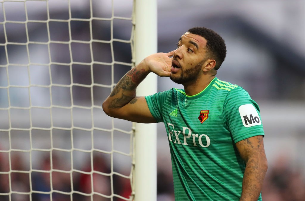 WOKING, ENGLAND - JANUARY 06: Troy Deeney of Watford listens to the fans during the FA Cup Third Round match between Woking and Watford at Kingfield Stadium on January 6, 2019 in Woking, United Kingdom. (Photo by Catherine Ivill/Getty Images)
