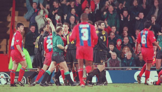 Eric Cantona is sent off - seconds later he aims a kung-fu kick at Palace fan Matthew Simmons.