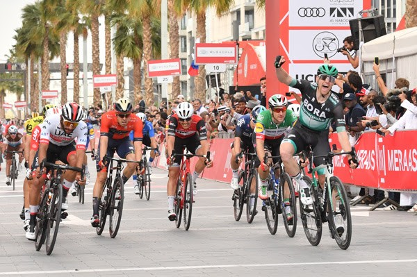 Sam Bennett of Bora-Hansgrohe edges out the UAE's Fernando Gaviria on Stage 7.