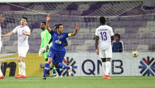 Mohammad Al Shalhoub celebrates his winning goal for Al Hilal in the reverse game.