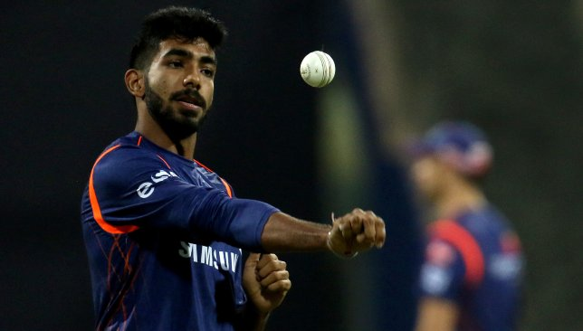 Jasprit Bumrah is in focus.