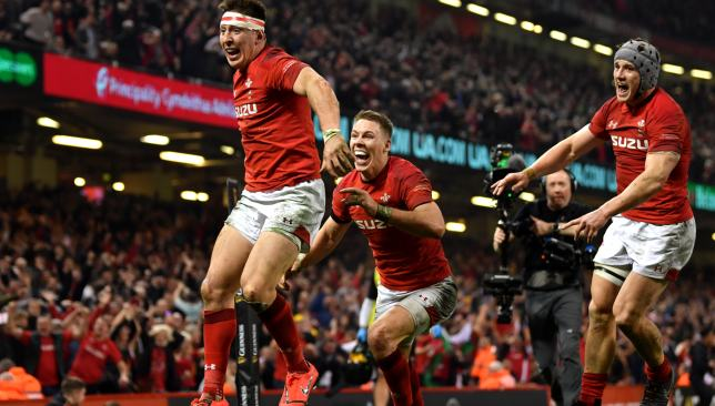 Josh Adams celebrates his game-clinching try against England with Liam Williams and Jonathan Davies.