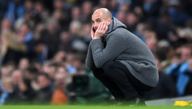 In a spot of bother: Pep Guardiola.