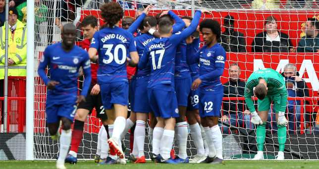 De Gea hangs his head as Chelsea celebrate Alonso's goal.