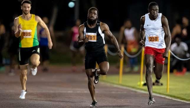 Omari Barton-Ellington (c) ran a blistering 10.34 100m to set a new seniors' record.