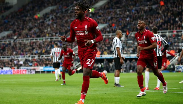 Divock Origi celebrates scoring against Newcastle