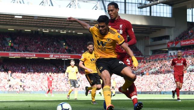 Raul Jimenez battles for the battl with Virgil van Dijk