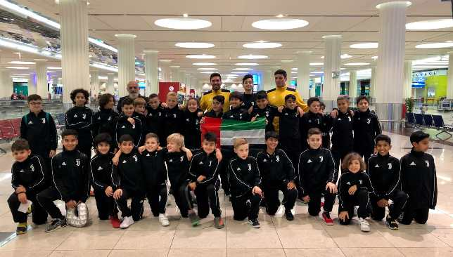 The Juve youngsters with their coaches at Dubai International Airport.
