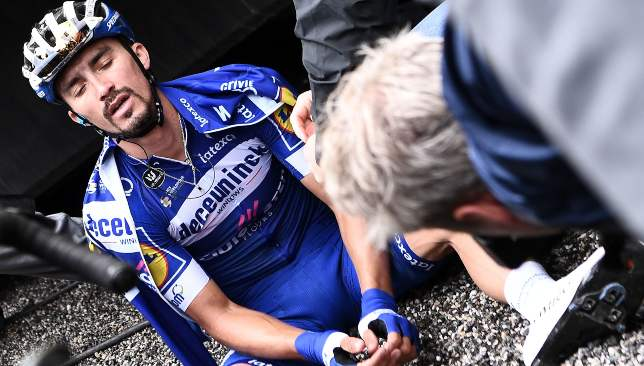 An exhausted Alaphilippe saw his feint hopes ended on Stage 20.