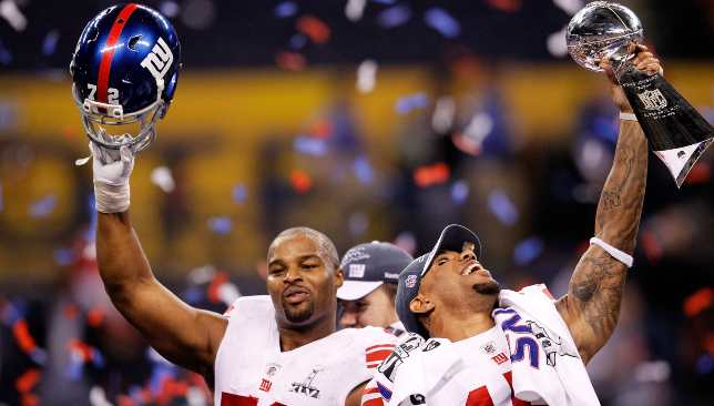 Umenyiora (l) with Giants team-mate Devin Thomas after beating the Patriots again in 2012.