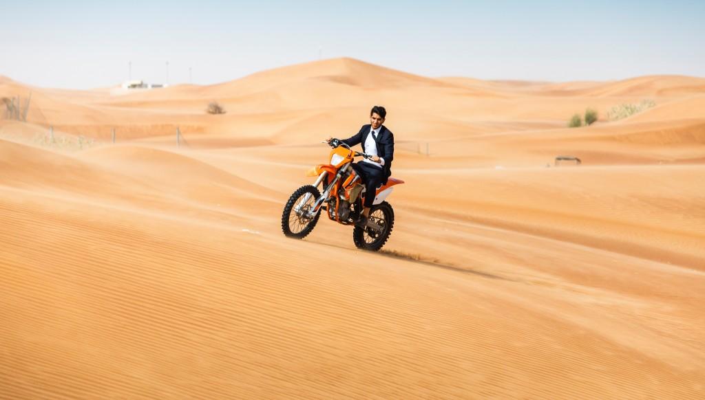 Riding high: Omar Farooq tackling the Dubai desert