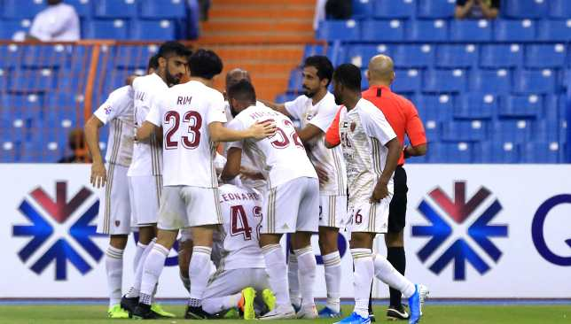 Wahda players celebrate Leonardo's (No42) equaliser.