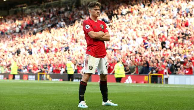 Dan James celebrates his fine goal in front of the Stretford End.