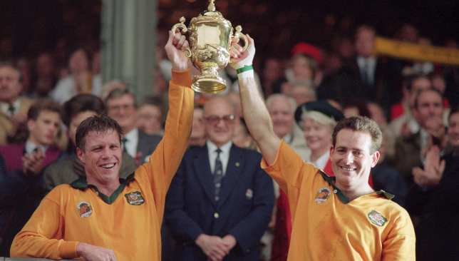 Wallabies Nick Farr-Jones and David Campese hold the trophy aloft in 1991.