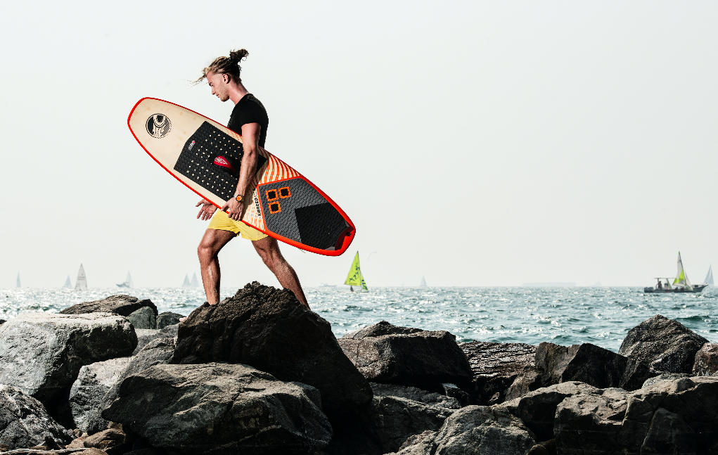 Rocking out: A kite surfer heads to the ocean