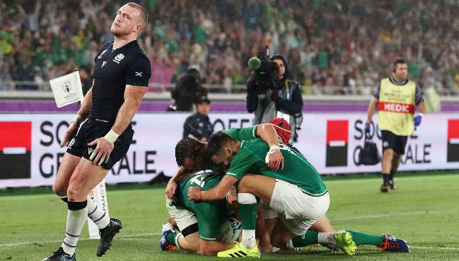 An exasperated Stuart Hogg looks on as Ireland score a try.