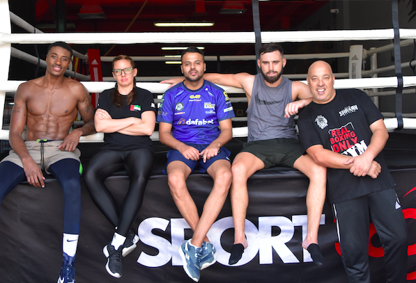 Team work: Ryan Kelly (2nd left) has made Dubai his permanent boxing base