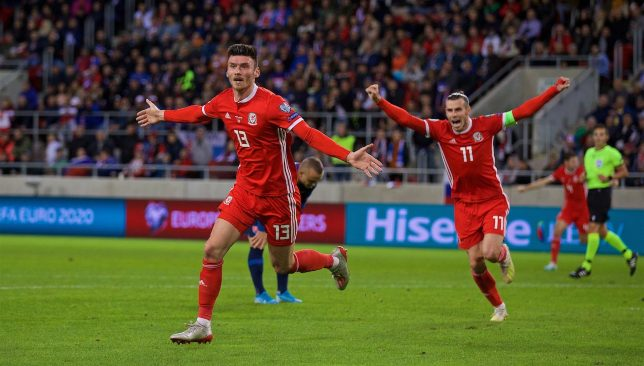 Bale celebrates alongside Moore after his opener against Slovakia. (Credit: Wales FA/Twitter)