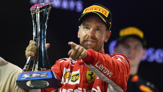 Sebastian Vettel with his second-place trophy in 2018.