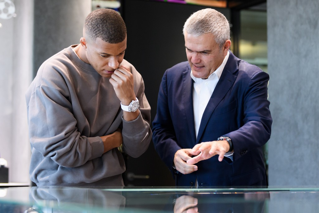 A meeting of minds: Kylian Mbappé chats with CEO Ricardo Guadalupe