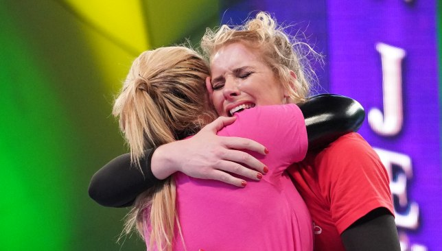 Natalya and Lacey Evans embrace at the conclusion of their match.