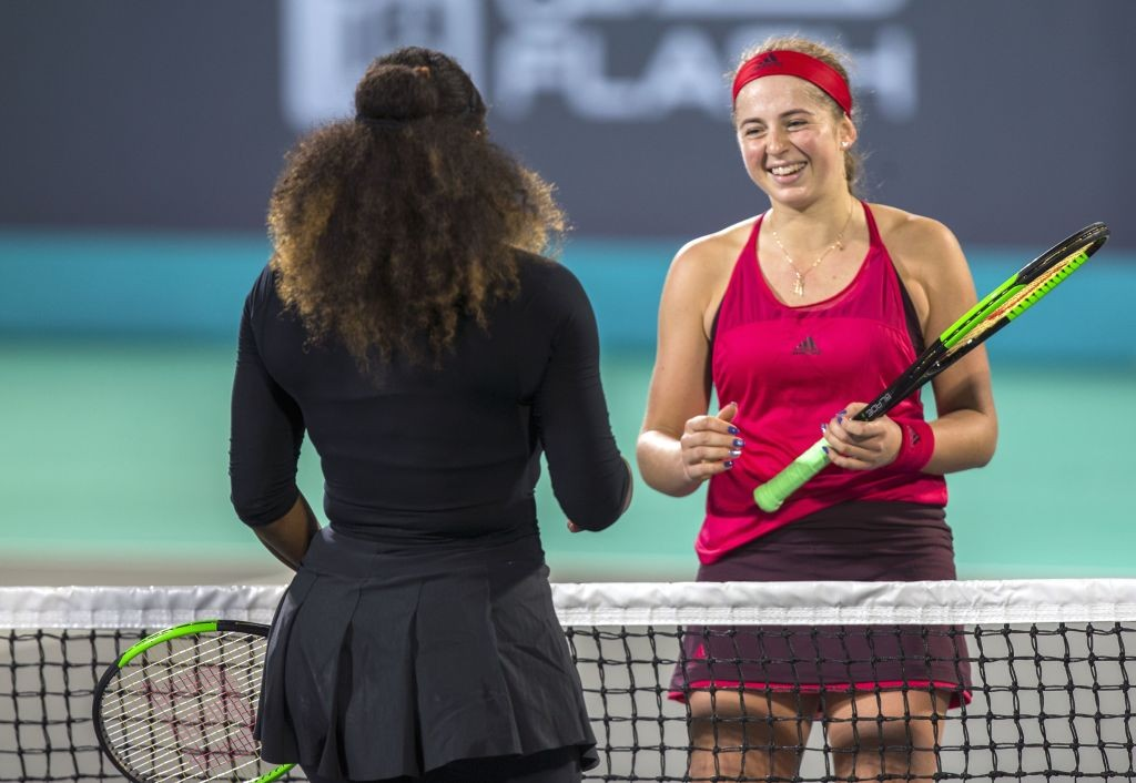 All smiles: The Latvian greets Williams at the net