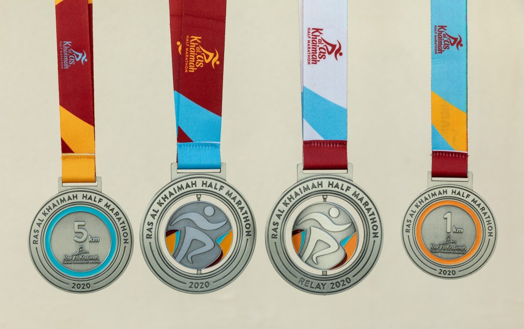 The four different types of medals for the finishers.