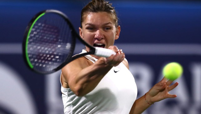 Seeded Halep rallies to set up Dubai semifinal against Brady