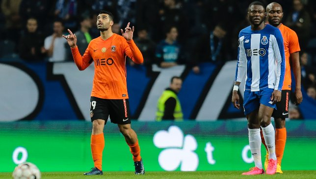 Mehdi Taremi (l) celebrates scoring against Porto in March (EPA).
