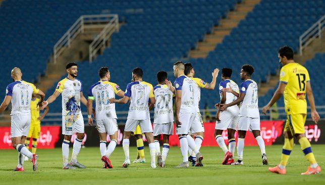 Al Nassr celebrate versus Al Taawoun (EPA).