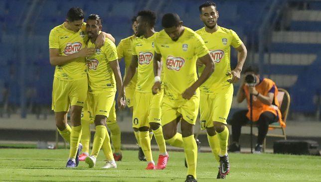 Al Ain players celebrate against Ettifaq (EPA).
