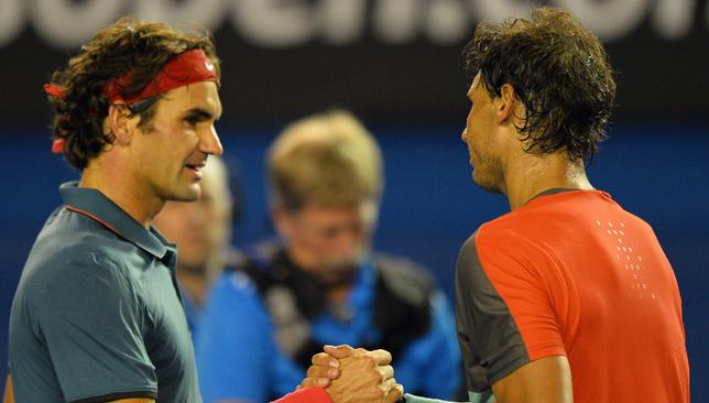Unimpressed: Federer (l) had some choice words about Nadal's antics.