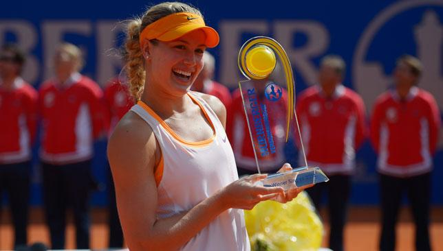 Head down: Eugenie Bouchard celebrates with the trophy after winning the Nuernberger Versicherungscup last month.