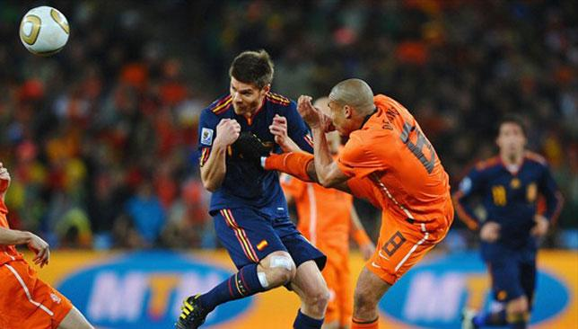 Battle: Xabi Alonso was on the end of a brutal kick from Nigel de Jong in the 2010 final.