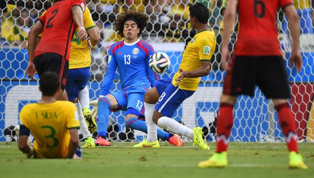 Formidable: Ochoa could not be breached as Mexico held Brazil to a goalless draw.