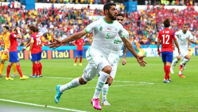 Dreamland: Algeria's Rafik Halliche celebrates scoring his side's second goal.
